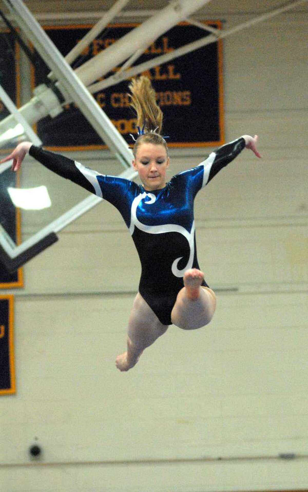 Charlotte Morgan from Darien High School competes at the FCIAC Gymnastics Championships at Westhill High School on Friday February 12, 2010.