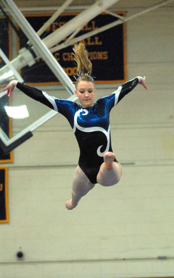 Charlotte Morgan from Darien High School competes at the FCIAC Gymnastics Championships at Westhill High School on Friday February 12, 2010. Photo: Dru Nadler / Stamford Advocate