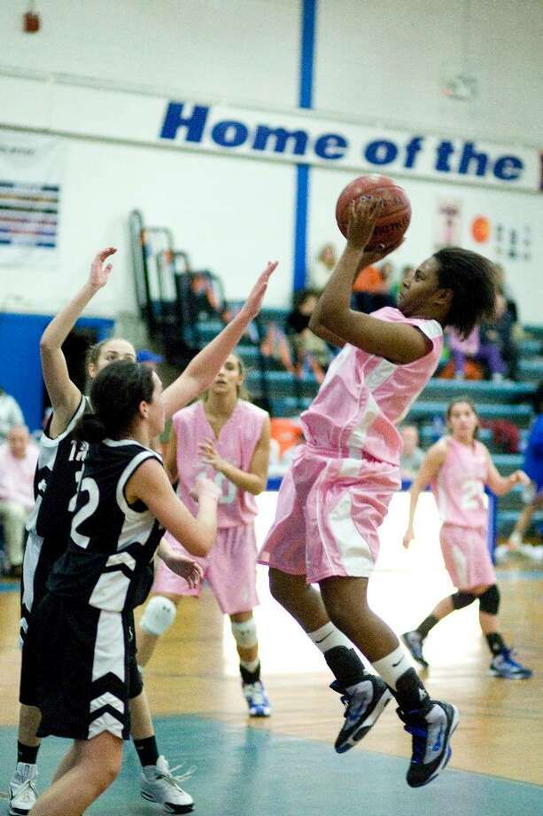 Danbury's Jasmine Holmes, one of the three Hatters honored at Senior Night, puts up a jump shot in an FCIAC game against Trumbull Friday night at Danbury High. Photo: Barry Horn / The News-Times Freelance