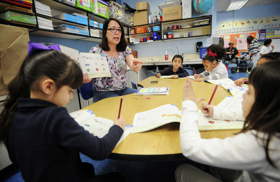 Evelyn Barrios works with her students in her dual language kindergarten class at Luis Munoz Marin School in Bridgeport, Conn. on Wednesday, March 5, 2014. Photo: Brian A. Pounds / Connecticut Post