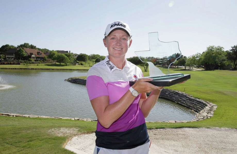 Stacy Lewis posses for photos with the trophy after winning the North Texas LPGA Shootout golf tournament at Las Colinas Country Club in Irving, Texas, Sunday, May 4, 2014. (AP Photo/LM Otero) Photo: LM Otero, STF / AP