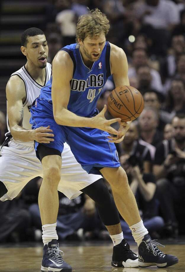 Dallas Mavericks' Dirk Nowitzki tries to get control of the ball as San Antonio Spurs' Danny Green defends during the first half of game seven in the first round of the Western Conference Playoffs at the AT&T Center, Sunday, May 4, 2014. Photo: San Antonio Express-News