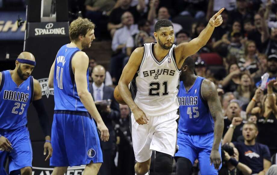 San Antonio Spurs' Tim Duncan reacts after scoring during first half action of Game 7 in the first round of the Western Conference playoffs against the Dallas Mavericks Sunday May 4, 2014 at the AT&T Center. Photo: San Antonio Express-News