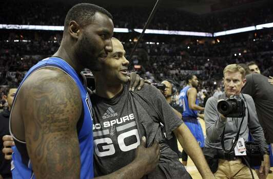 Dallas Mavericks' DeJuan Blair and San Antonio Spurs' Tony Parker hug after Game 7 in the first  round of the Western Conference playoffs  Sunday May 4, 2014 at the AT&T Center. The Spurs won 119-96. The Spurs advance to face Portland in the Western Conference semifinals. Photo: San Antonio Express-News