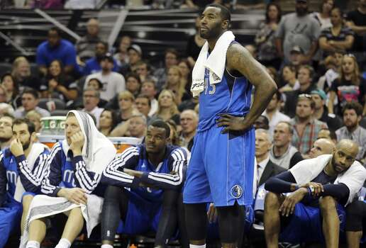 Dallas Mavericks' DeJuan Blair and teammates watch action from the bench late in Game 7 of the first round in the Western Conference playoffs against the San Antonio Spurs Sunday May 4, 2014 at the AT&T Center. The Spurs won 119-96. The Spurs advance to face Portland in the Western Conference semifinals. Photo: San Antonio Express-News