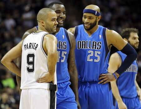 San Antonio Spurs' Tony Parker talks with Dallas Mavericks' DeJuan Blair and Vince Carter during first half action of Game 7 in the first  round of the Western Conference playoffs  Sunday May 4, 2014 at the AT&T Center. Photo: San Antonio Express-News