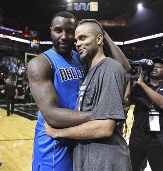 San Antonio Spurs' Tony Parker hugs Dallas Mavericks' DeJuan Blair at the end of game seven in the first round of the Western Conference Playoffs at the AT&T Center, Sunday, May 4, 2014. The Spurs won, 119-96 to move on to the conference semi-finals against the Portland Trailblazers. Photo: San Antonio Express-News