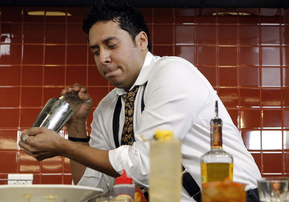 Jeret Peña shakes up a cocktail during the Latin Flavors conference at the Culinary Institute of America. Photo: Michael Miller / For The San Antonio Express-News / mmiller@express-news.net