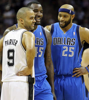 San Antonio Spurs' Tony Parker talks with Dallas Mavericks' DeJuan Blair and Vince Carter during first half action of Game 7 in the first  round of the Western Conference playoffs  Sunday May 4, 2014 at the AT&T Center. Photo: Edward A. Ornelas, San Antonio Express-News / © 2014 San Antonio Express-News