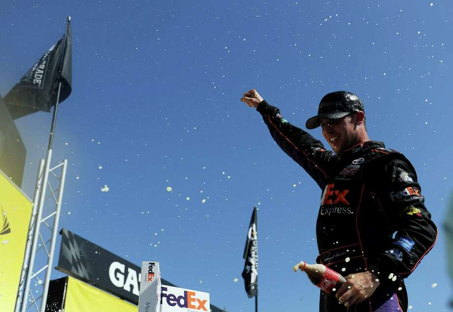 TALLADEGA, AL - MAY 04:  Denny Hamlin, driver of the #11 FedEx Express Toyota, celebrates in Victory Lane after winning the NASCAR Sprint Cup Series Aaron's 499 at Talladega Superspeedway on May 4, 2014 in Talladega, Alabama.  (Photo by Patrick Smith/Getty Images) ORG XMIT: 463755105 Photo: Patrick Smith / 2014 Getty Images
