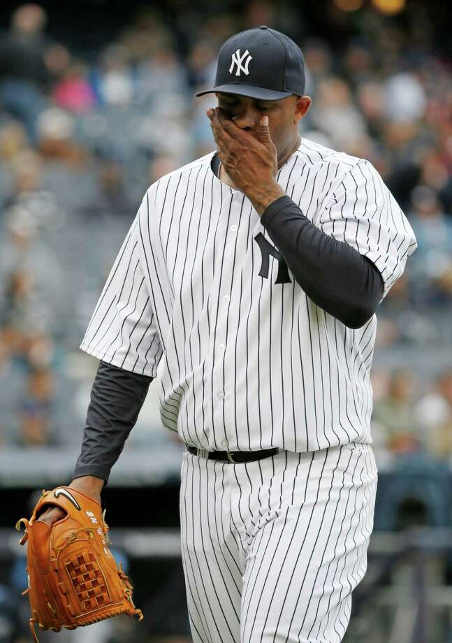 New York Yankees starting pitcher CC Sabathia comes out out of a baseball game against the New York Yankees at Yankee Stadium in New York, Sunday, May 4, 2014. (AP Photo/Kathy Willens) ORG XMIT: NYY120 Photo: Kathy Willens / AP