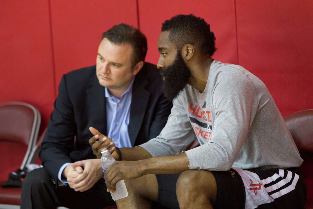 Rockets general manager Daryl Morey, left, talking with James Harden at a 2014 practice.