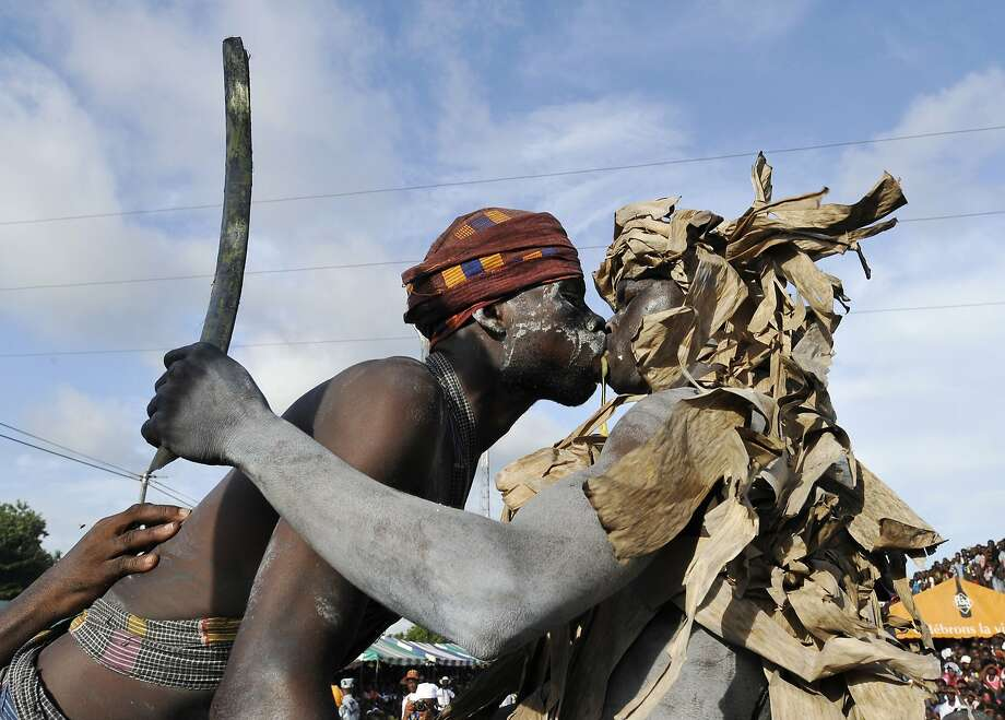 TOPSHOTS Youths from the Aboure tribe perform a warrior dance as they take part in a parade during a ceremony on the last day of the 34th Popo carnival in Bonoua, 60km south of Abidjan, on May 3, 2014. The festival this year promotes national reconciliation. AFP PHOTO / SIA KAMBOUSIA KAMBOU/AFP/Getty Images Photo: Sia Kambou, AFP/Getty Images