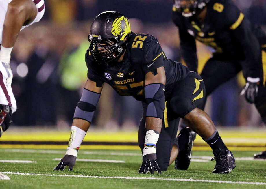 Defensive end Michael Sam was named the Southeastern Conference co-Defensive Player of the Year last season at Missouri. Photo: Jeff Roberson, STF / AP