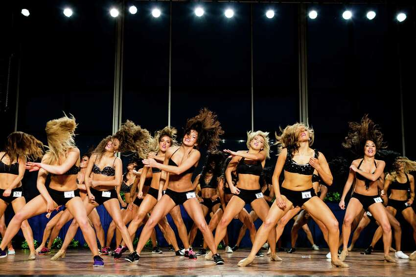 Finalists for the 2014 Sea Gals squad perform together at the auditions Sunday, May 4, 2014, at CenturyLink Field in Seattle. Final auditions included individual and group performances, along with a kick line section.