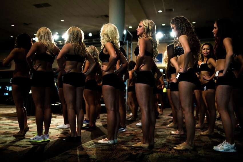 Contestants await the first round of dancers during the final auditions for the 2014 Sea Gals squad Sunday at CenturyLink Field in Seattle. Final auditions included individual and group performances, along with a kick line section.