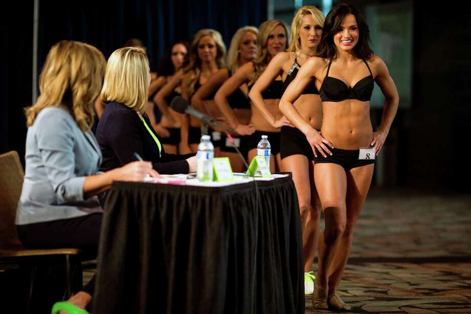 The first group of contestants prepare to dance during the final auditions for the 2014 Sea Gals squad Sunday at CenturyLink Field in Seattle. Final auditions included individual and group performances, along with a kick line section. Photo: JORDAN STEAD, SEATTLEPI.COM / SEATTLEPI.COM