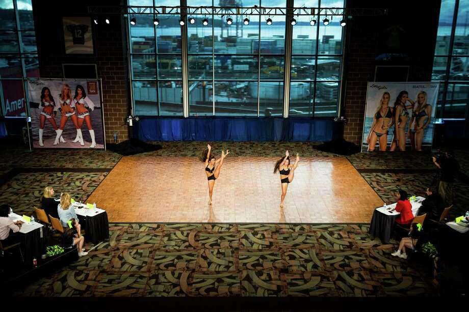 Contestants perform during the final audition for the 2014 Sea Gals squad Sunday at CenturyLink Field in Seattle. Final auditions included individual and group performances, along with a kick line section. Photo: JORDAN STEAD, SEATTLEPI.COM / SEATTLEPI.COM