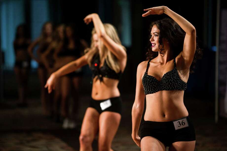 Margarita, right, performs alongside another contestant during the final audition for the 2014 Sea Gals squad Sunday at CenturyLink Field in Seattle. Final auditions included individual and group performances, along with a kick line section. Photo: JORDAN STEAD, SEATTLEPI.COM / SEATTLEPI.COM