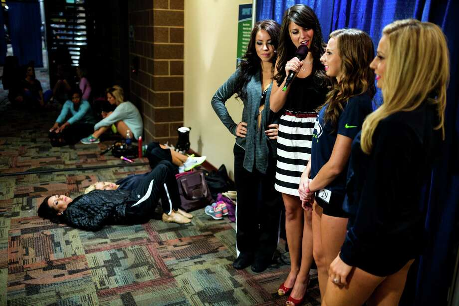 Nervous contestants are interviewed backstage on their performances while awaiting the results of the final audition for the 2014 Sea Gals squad Sunday at CenturyLink Field in Seattle. Final auditions included individual and group performances, along with a kick line section. Photo: JORDAN STEAD, SEATTLEPI.COM / SEATTLEPI.COM