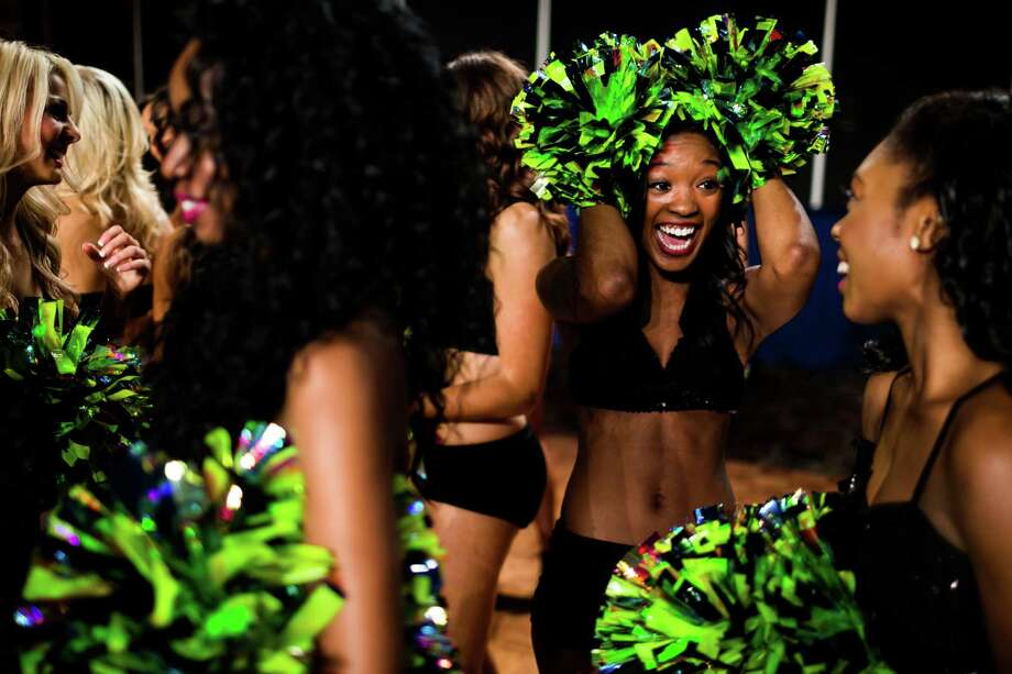 DeDjauna, right, reacts to being selected for the 2014 Sea Gals squad Sunday at CenturyLink Field in Seattle. Final auditions included individual and group performances, along with a kick line section. Photo: JORDAN STEAD, SEATTLEPI.COM / SEATTLEPI.COM