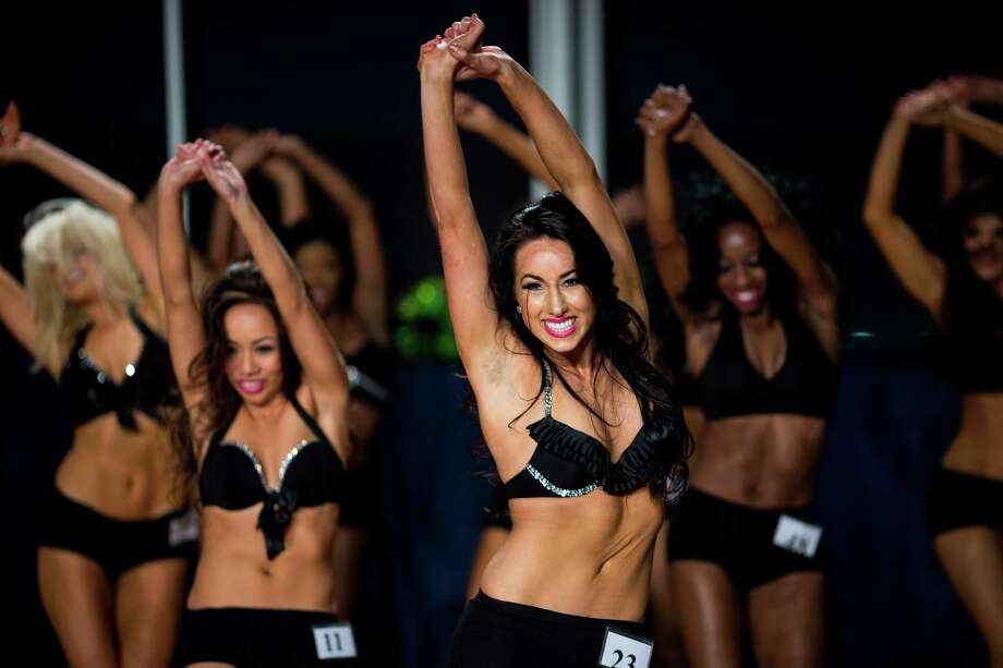 Finalists for the 2014 Sea Gals squad perform one more dance together at the auditions Sunday at CenturyLink Field in Seattle. Final auditions included individual and group performances, along with a kick line section. Photo: JORDAN STEAD, SEATTLEPI.COM / SEATTLEPI.COM