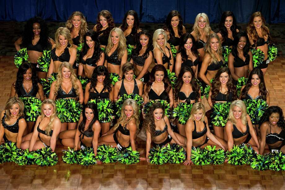 Thirty-two of the 2014 Sea Gals squad finalists photographed Sunday at CenturyLink Field in Seattle. Final auditions included individual and group performances, along with a kick line section. Photo: JORDAN STEAD, SEATTLEPI.COM / SEATTLEPI.COM