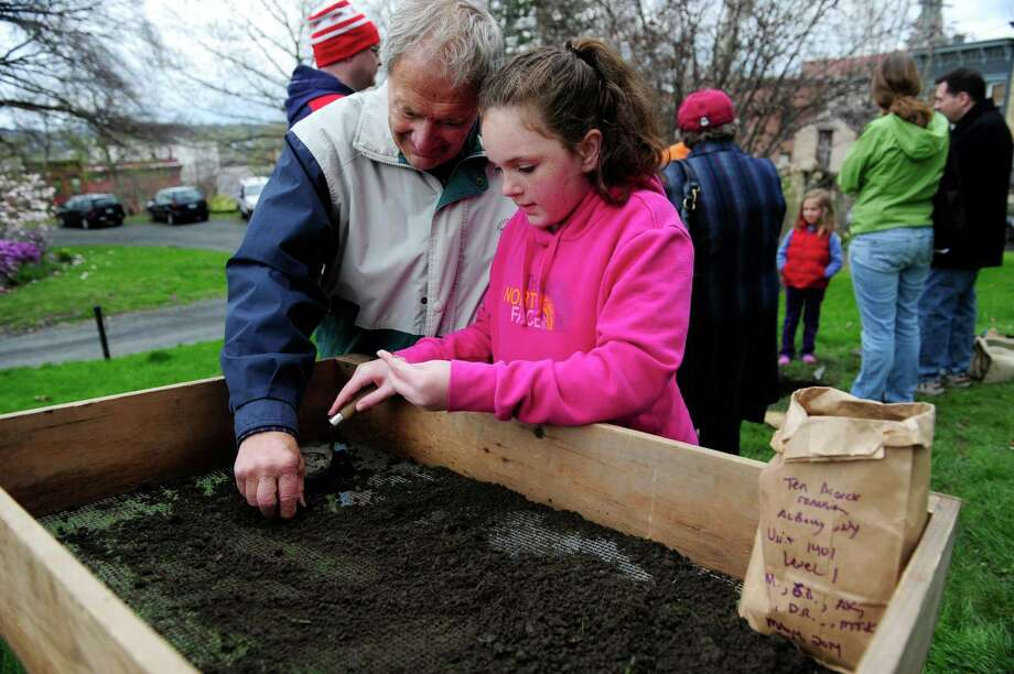 Maynard Daigle, left, of Waterford, and his granddaughter Maci Haar, 10, of Colonie look for artifacts during the Living History Day: Hidden Treasures of Albany event at Ten Broeck Mansion on Sunday, May 4, 2014, in Albany, N.Y.  Visitors were able to sift through dirt from the property to look for historical artifacts.  (Paul Buckowski / Times Union) Photo: Paul Buckowski / 00026702A