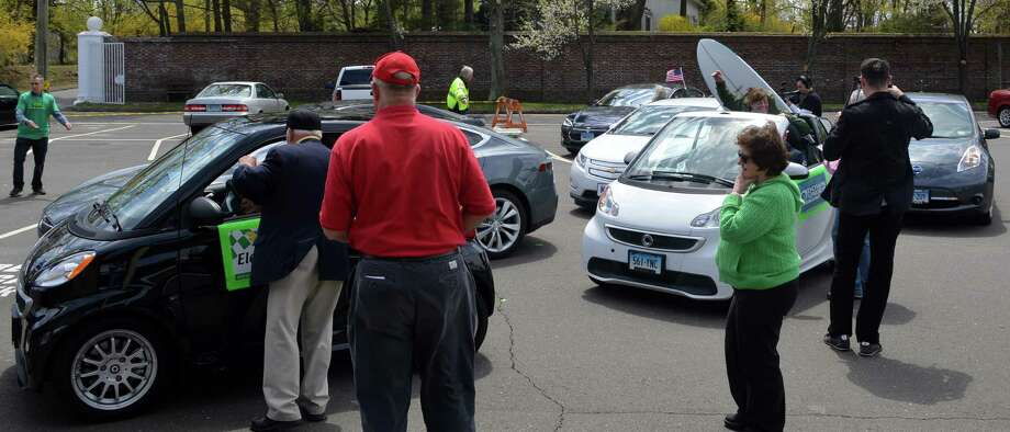At the finish line mileage of Sunday's 2nd annual EV Road Rally odometers were checked to see which drivers came closest to completing the rally at the designated distance of 38.5 miles. The event was sponsored by the Westport Electric Car Club. Photo: Jarret Liotta / Westport News