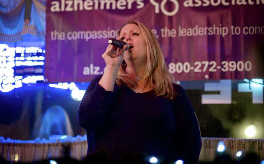 "Margaret McDonagh, 45, of Kent, sings ""Grandpa,"" by The Judds, during ""Karaoke for a Cause"" at S.J. Barrington's Cafe & Grill, in New Milford, Conn., on Saturday night, May 3, 2014. McDonagh urged her her childhood friend, Joann Rodriguez, 46, to enter the contest with her. Rodriguez wound up winning first prize. Photo: H John Voorhees III / The News-Times Freelance"