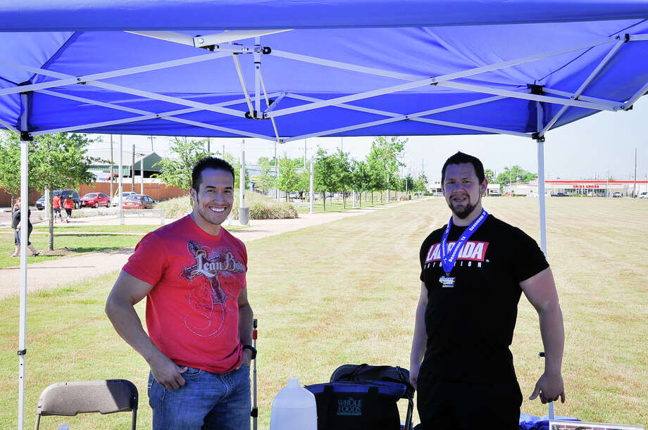 Vinny Hickerson and Ryan Workman were seen at their booth during the Biggest Loser Run Saturday in downtown Beaumont, Tx. Photo by Michael Reed Photo: Michael Reed / Michael Reed
