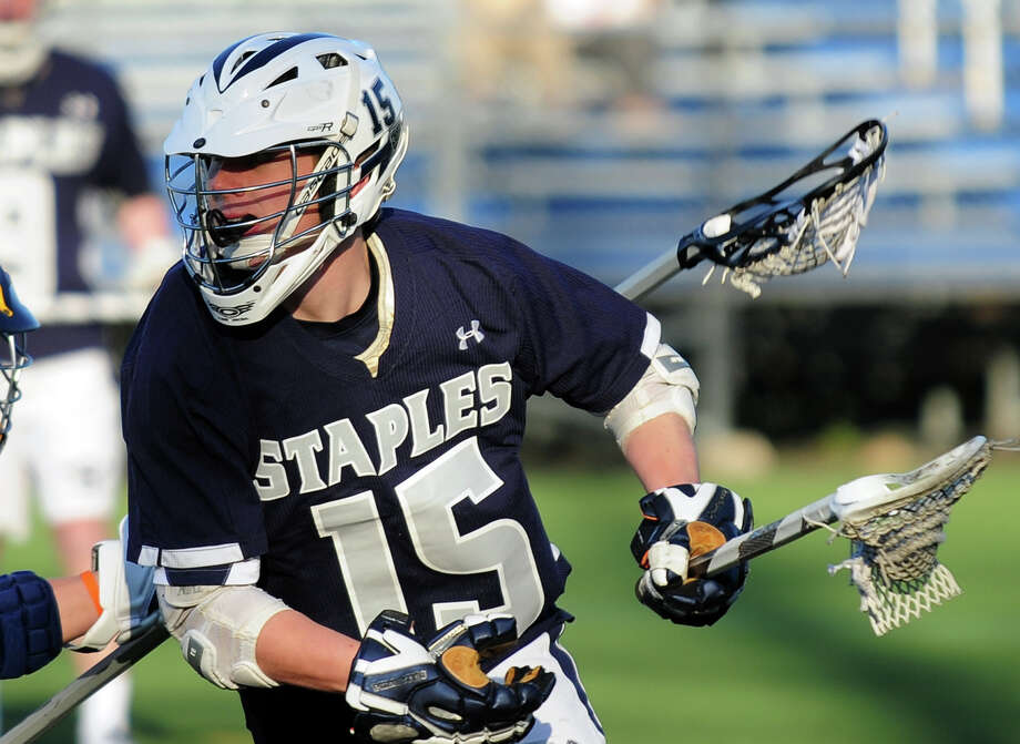 Staples Will Johnson, during lacrosse action against Weston in Westport, Conn. on Wednesday April 9, 2014. Photo: Christian Abraham / Connecticut Post