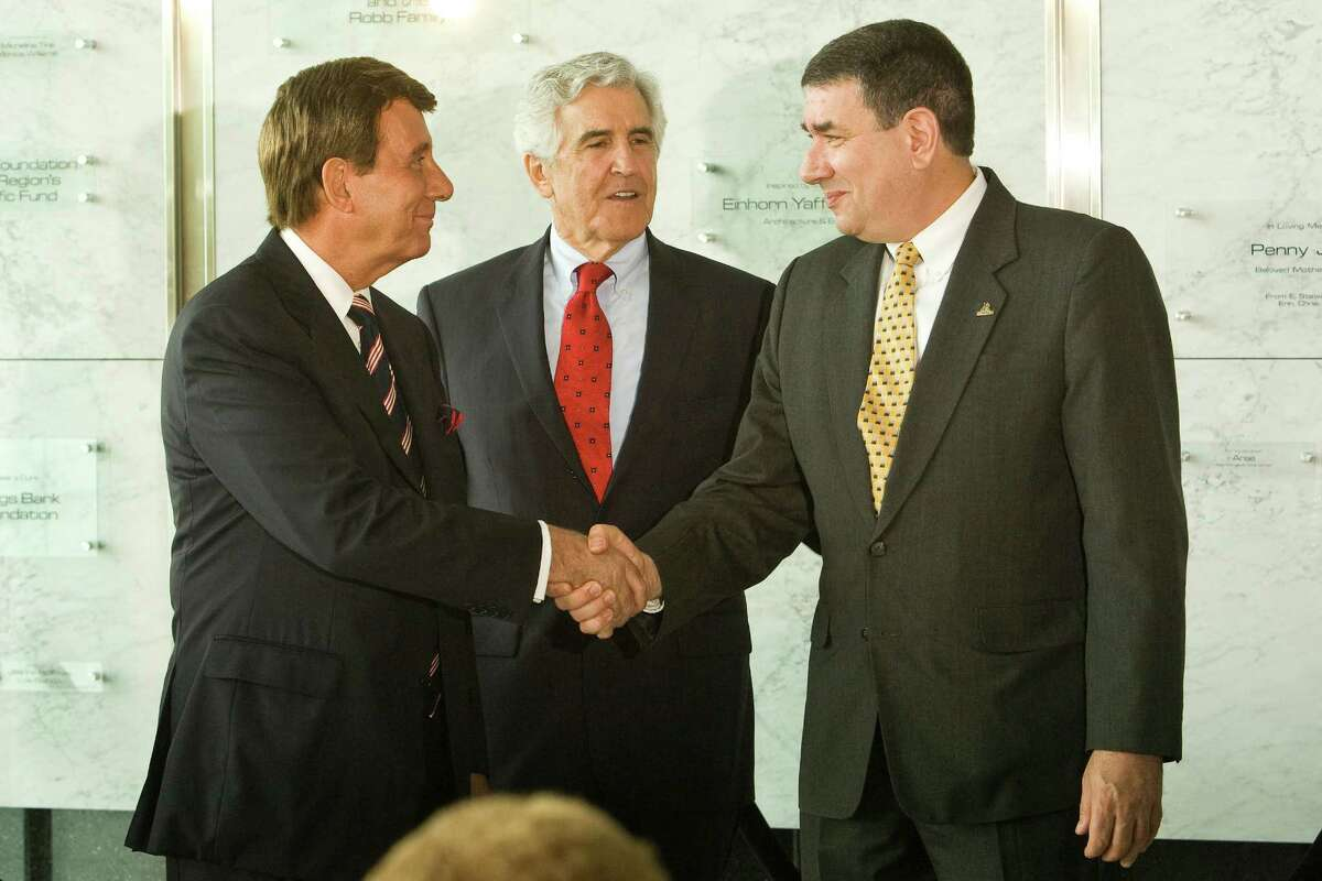 James Barba, left, president of Albany Medical Center, shakes hands with George Phillips, interim president of SUNY Albany, as state Sen. Joseph L. Bruno looks on. They announced a collaboration Monday, July 14, 2008, that will expand biomedical research in the Capital Region while giving students the opportunity to earn dual degrees in medicine and public health. The centerpiece of the collaboration will be a $42 million Institute for Biomedical Education and Research, which will be built at UAlbany's East Campus in East Greenbush.