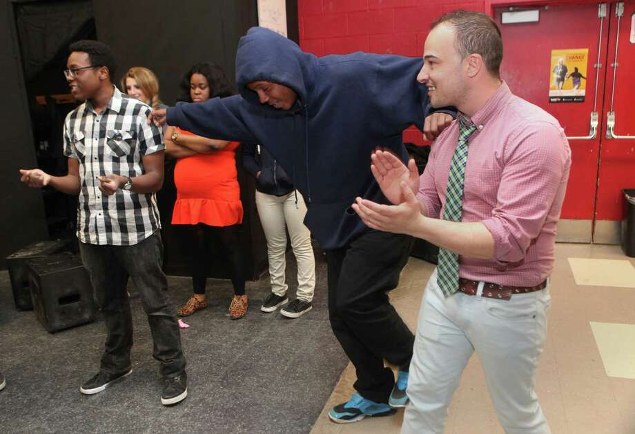 Central High school Shaun Mitchell, far right, teaches an intro to theater on Monday , April 28, 2014. Mitchell won the Beard award this year. Mitchell and students create a beat circle. Photo: BK Angeletti, B.K. Angeletti / Connecticut Post freelance B.K. Angeletti