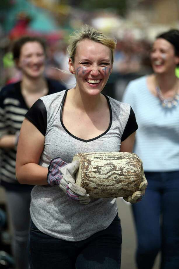 A competitor takes her wooden 'cheese' up to the start line during the Stilton Village Festival cheese rolling competition on May 5, 2014 in Stilton, England. The Stilton annual cheese rolling competition, which is held annually on every May Day Bank Holiday involves teams of four competing against each other by rolling cheese down the High Street to be crowned the 'Stilton Cheese Rolling Champions'. Photo: Jordan Mansfield, Getty Images / 2014 Getty Images