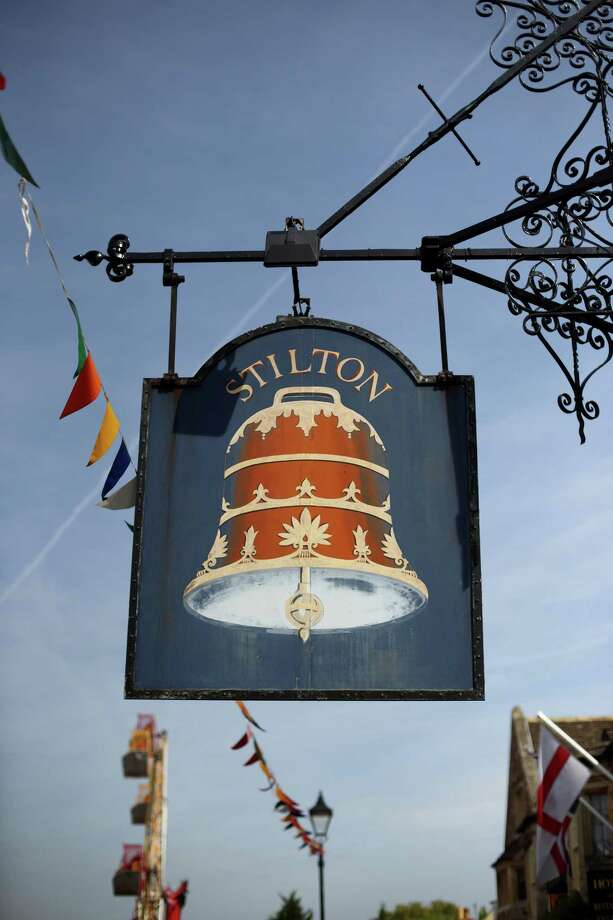 A general view of a pub sign for the Bell Inn on Stilton High Street on May 5, 2014 in Stilton, England. The Stilton annual cheese rolling competition, which is held annually on every May Day Bank Holiday involves teams of four competing against each other by rolling cheese down the High Street to be crowned the 'Stilton Cheese Rolling Champions'. Photo: Jordan Mansfield, Getty Images / 2014 Getty Images