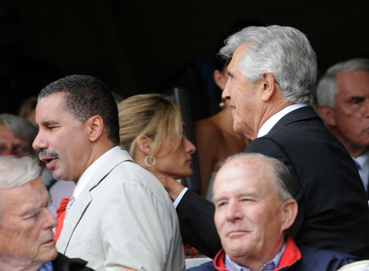 Governor David Paterson is pushed through the crowd by ex Senator Joseph Bruno before the 140th running of The Travers at the Saratoga Race Course in Saratoga Springs, New York August 29, 2009.