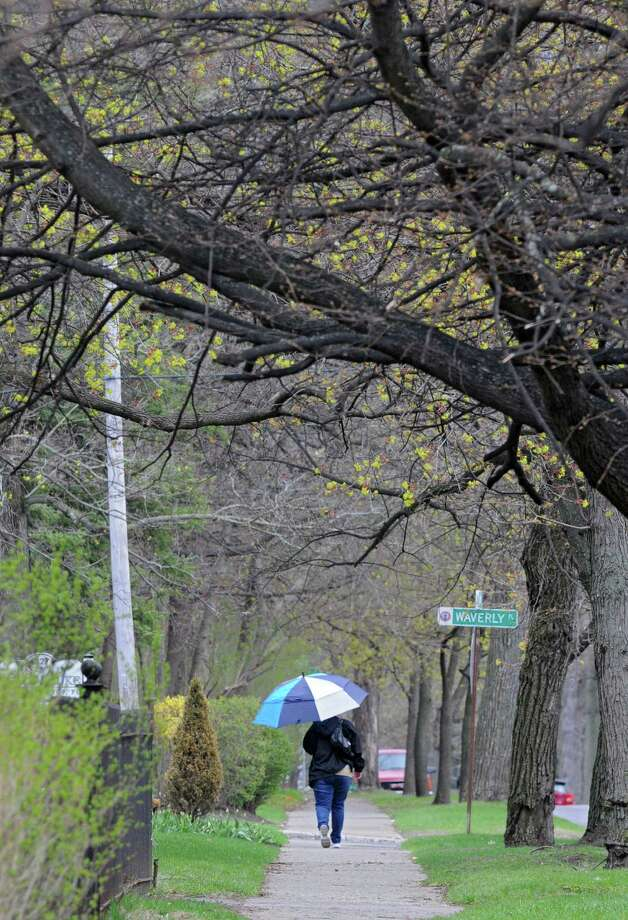 A woman walks with an umbrella along Union Ave. on Friday, May 2, 2014 in Schenectady, N.Y. Rain fell on and off during the day in the region. (Lori Van Buren / Times Union) Photo: Lori Van Buren, Albany Times Union