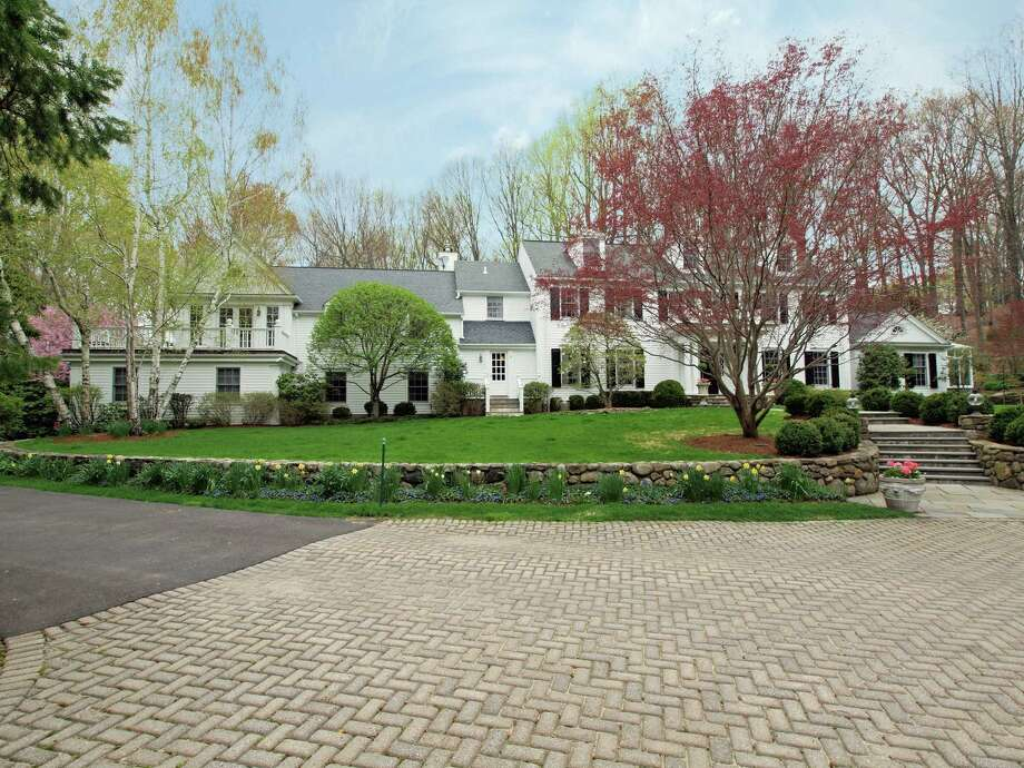 The Colonial at 627 Laurel Road in New Canaan offers private luxury living on 4.34 acres in the northeast part of town. It is on the market for $2,599,000. Photo: Contributed Photo, Contributed / New Canaan News Contributed