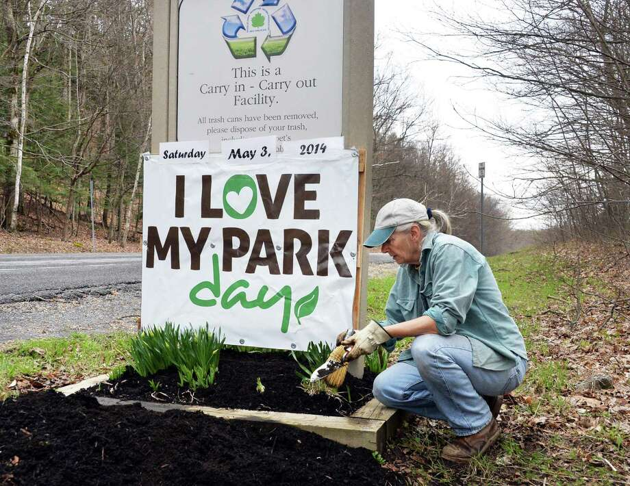 Thatcher Park Garden Gang's Bonnie Schaller of Altamont cleans a flower bed at the entrance to Thatcher State Park Friday May 2, 2014, in preparation of Saturday's I Love My Park day in Voorheesville, NY.   (John Carl D'Annibale / Times Union) Photo: John Carl D'Annibale, Albany Times Union
