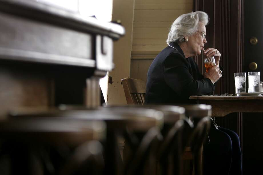 Leah Green sips iced tea as she waits for brunch with her husband, Hubert, at the Liberty Bar in 2006. Photo: Liza Krantz, Express-News