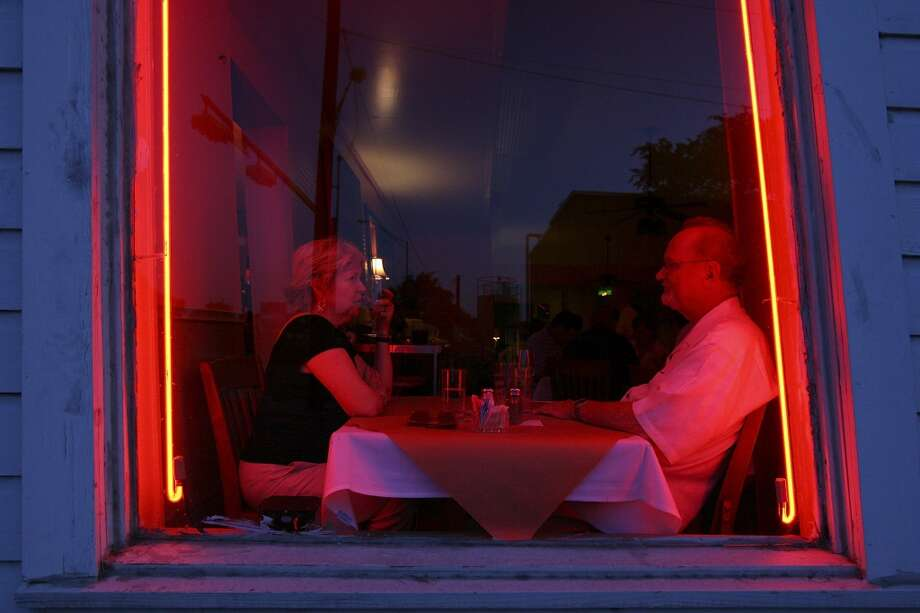 Judy (left) and George Schroeder enjoy dinner at Liberty Bar in 2009. Photo: Edward A. Ornelas, Express-News