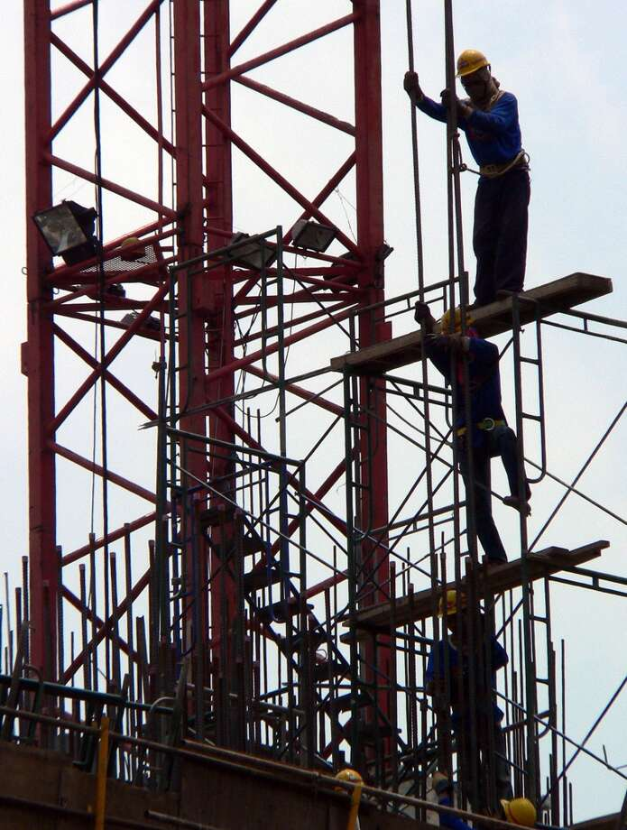 4. Thailand  Foreign workers: 2014 -- $143,200 2013 -- $142,400   Local workers: 2014 -- $59,300 2013 -- $49,400   [Photo: Thai labourers work at a commercial construction site in down town Bangkok, June 2005.] Photo: SAEED KHAN, AFP/Getty Images