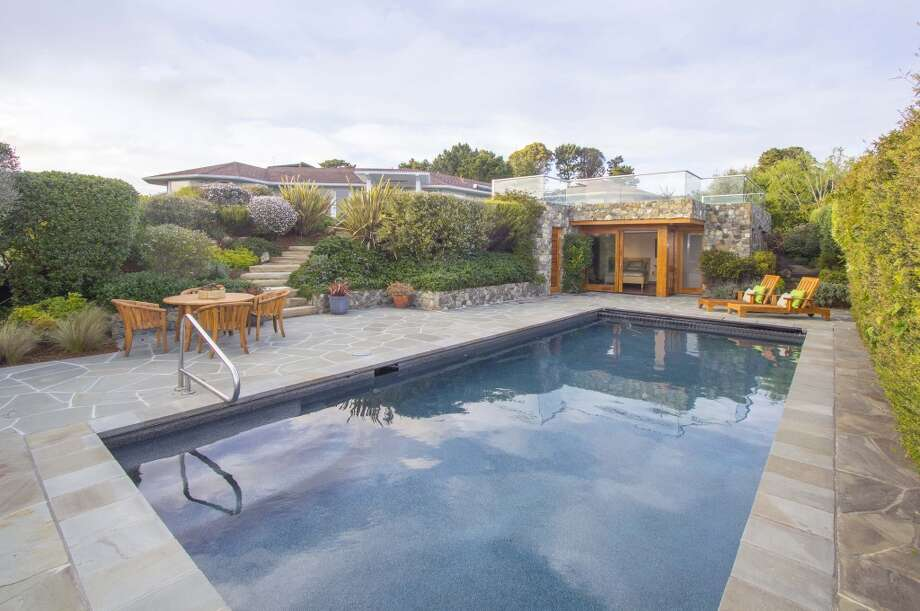 Another perspective of pool, guest house, grounds. Photo by Clay Seibert, courtesy Coldwell Banker.