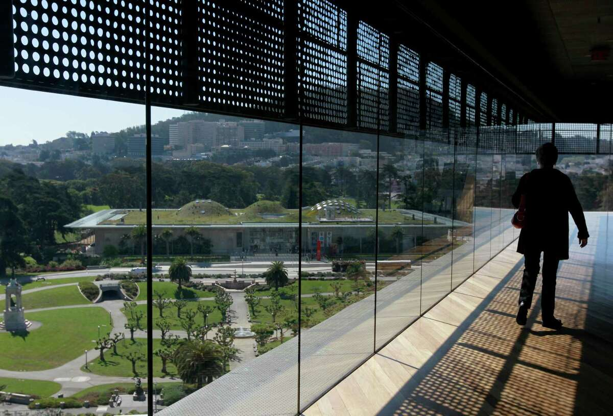 Visitors have a commanding view of the Academy of Sciences from the Hamon Observation Tower at the de Young Museum in San Francisco, Calif. on Wednesday, April 30, 2014. The free viewing deck is on the 44-O'Shaughnessy Muni bus route.