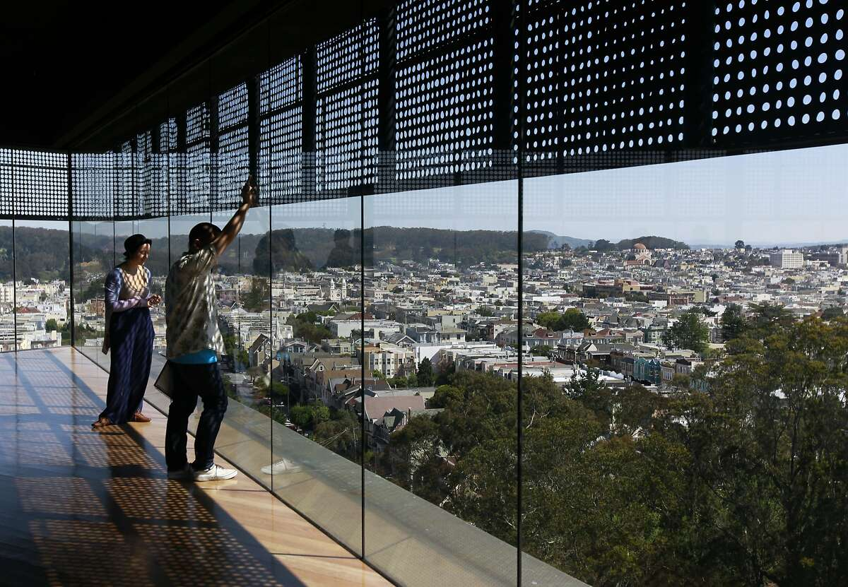 Visitors have a commanding view of Golden Gate Park and the city from the Hamon Observation Tower at the de Young Museum in San Francisco, Calif. on Wednesday, April 30, 2014. The free viewing deck is on the 44-O'Shaughnessy Muni bus route.