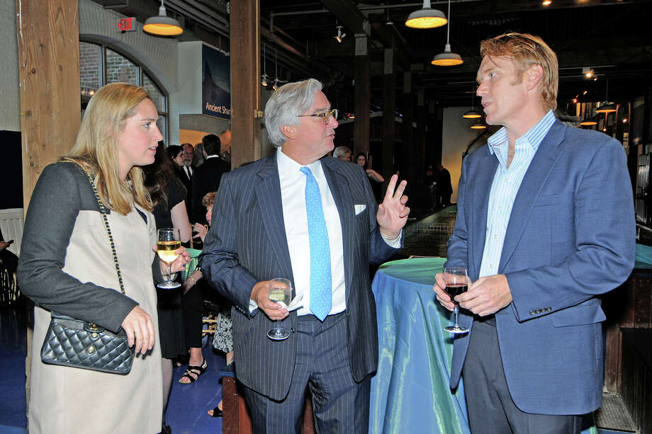 "Maritime Aquarium at Norwalk trustee Tom Lewis, of New Canaan, center, chats with Doug Grabe, of Fairfield, a member of the board of advisors, during the ""Cirque de la Mer"" fundraising gala April 24. At left, Lewis' daughter, Whitney. Photo: Contributed Photo, Contributed / New Canaan News"