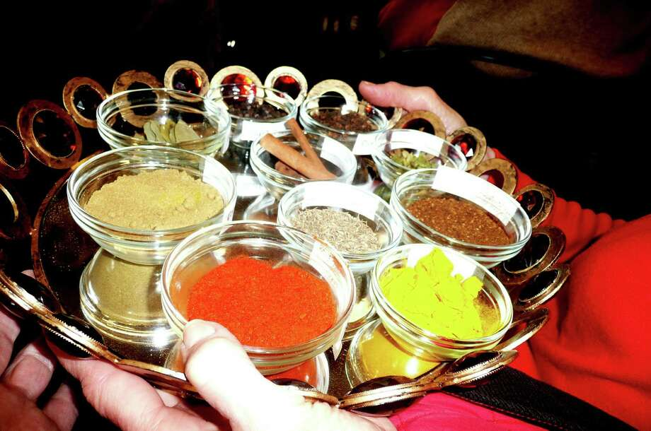 A tray of spices was passed around to Indian food fans at the Community Room of the Cos Cob Library who were there for a closer look at what goes into Indian cuisine- including paprika, ginger, saffron, mustard seeds cardamom, cloves, cinammon, cumin and turmeric. Photo: Anne Semmes / Greenwich Time