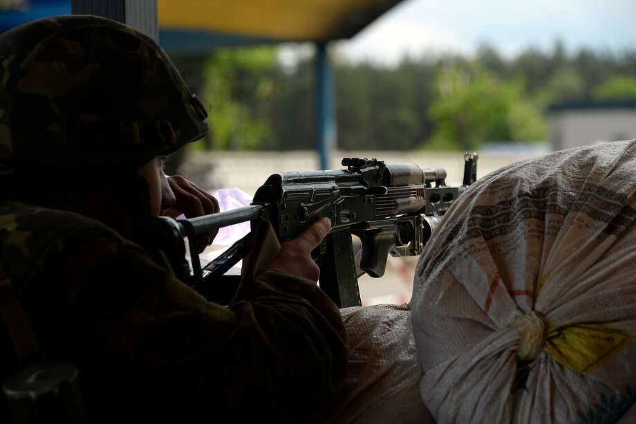 A Ukrainian soldier mans a checkpoint near Slovyansk, the focus of pro-Russian forces. Photo: Vasily Maximov, AFP/Getty Images