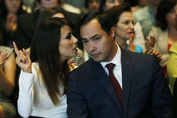 Actress Eva Longoria speaks with Rep. Joaquin Castro, D-Texas, at an event launching The Latino Victory Project, a Latino political action committee, at the National Press Club in Washington, Monday, May 5, 2014. (AP Photo/Charles Dharapak)